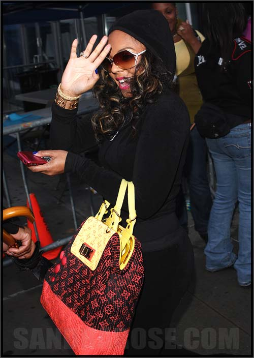 Raven-Symoné wears  (Bag )